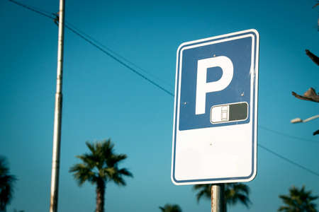 Closeup of the  parking sign in city