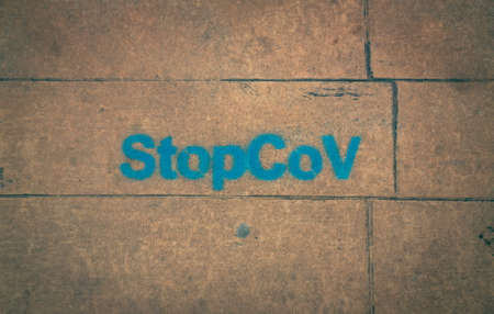 StopCov sign painted on the ground