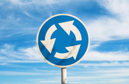 Closeup of the roundabout sign in city Imagens