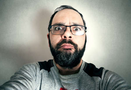 Funny man with the beard making expressions