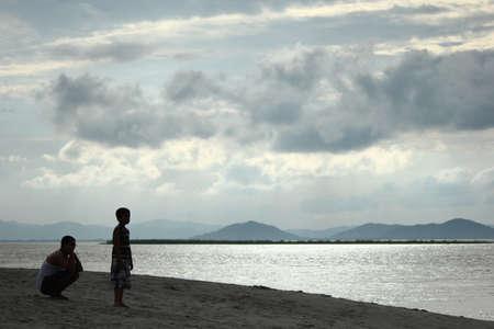 assam: a father and a son enjoying the view of the river Brahmaputra at Tatimara Kamrup Assam