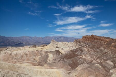 Undulating arid rocks of Zabriskie Point in the Death Valley National Park, with an high range of tonality, from bright tones to dark, the heaviness of matter, the lightness of air Imagens