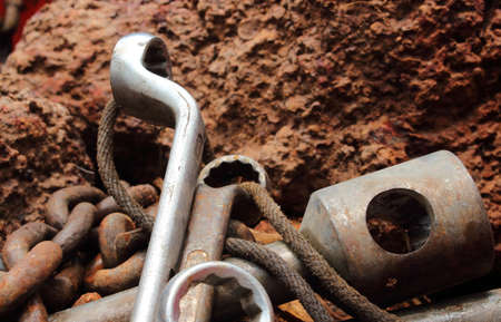 lay down: rusty tool  lay down in the rock background Stock Photo
