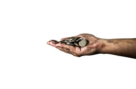 cheapness: dirty hand holding Thai coins isolated on a white background