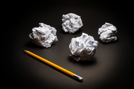 stress management: Pencil, crumpled paper on black background. Business frustrations, Job stress and Failed exam concept.