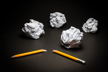 broken: Broken pencil, crumpled paper on black background. Business frustrations, Job stress and Failed exam concept.