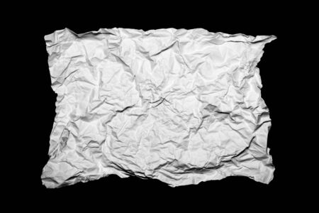 creased: White creased paper isolated on black background