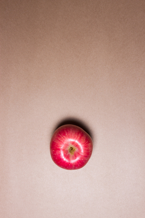 apple on brown paper background