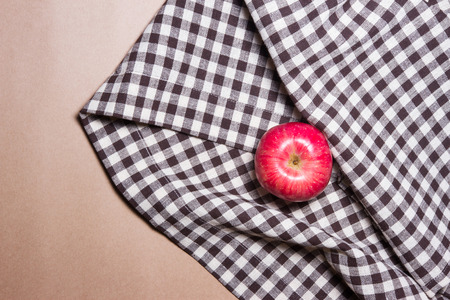 apple on brown table striped Fabric and brown paper background 版權商用圖片