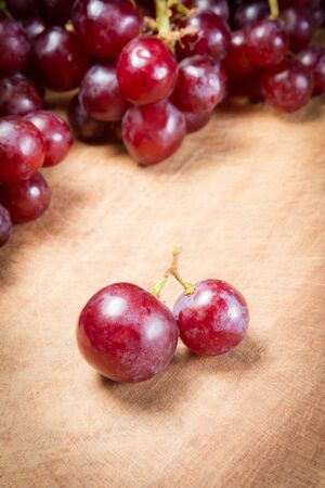 Red Grapes on a wooden table