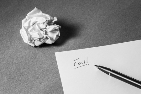 carta e penna: Fail hand writing on paper, pen and crumpled paper. Business frustrations, Job stress and Failed exam concept. Black and white filter.