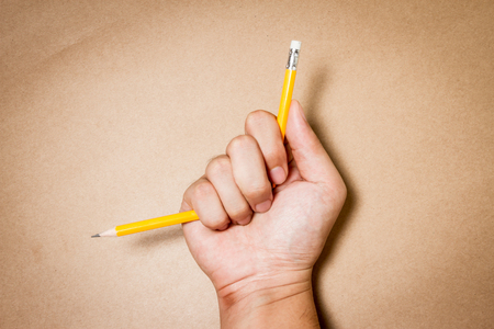 exam: Hand with broken pencil. Business frustrations, Job stress and Failed exam concept. Stock Photo