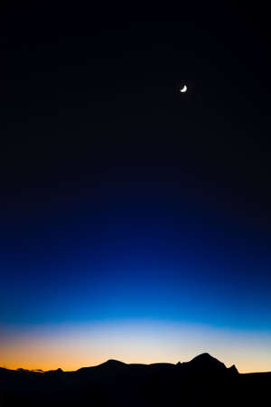 Moon on the Dark Blue Sky among mountains. Antarctica. Stock Photo - 6231348