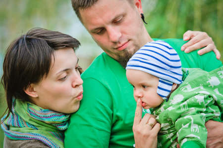 Happy family on a green background photo