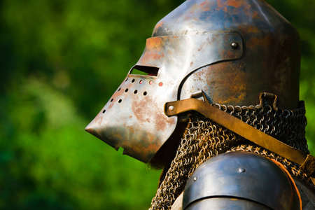 man in knight's helmet on a green background Stock Photo - 7852398