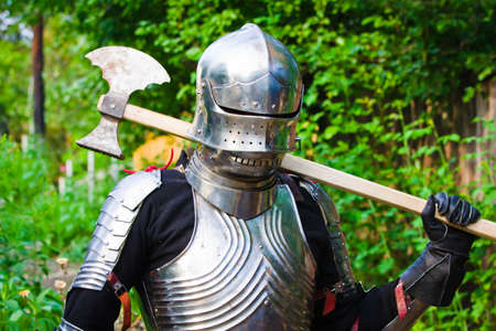 knight in shining armor on a green background photo