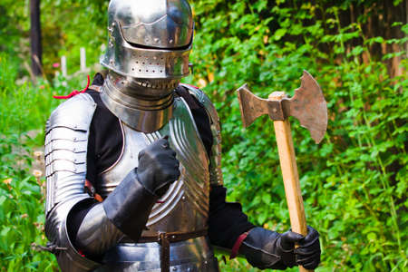 protective suit: knight in shining armor on a green background