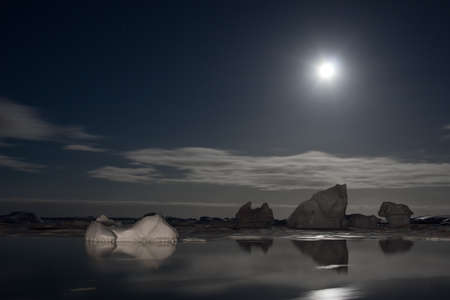 Summer night in Antarctica.Icebergs floating in the moonlight Stock Photo - 7942220