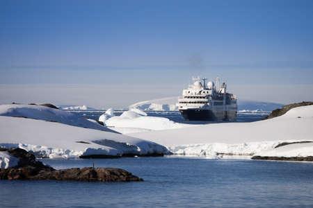Big cruise ship in Antarctic waters photo