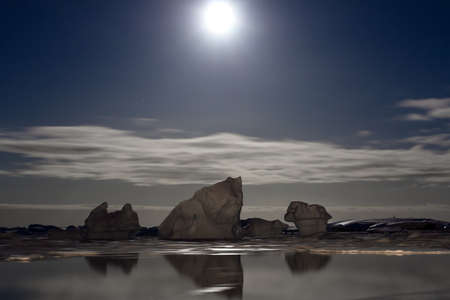 Summer night in Antarctica.Icebergs floating in the moonlight Stock Photo - 7942236