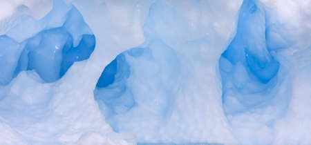 Large Arctic iceberg with a cavity inside Stock Photo