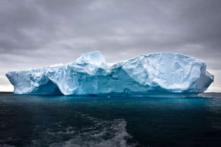to the north: Antarctic iceberg in the snow Stock Photo