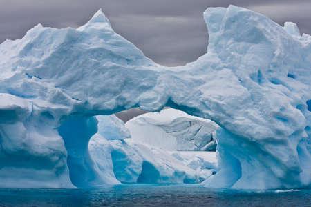 Large Arctic iceberg with a cavity inside Stock Photo