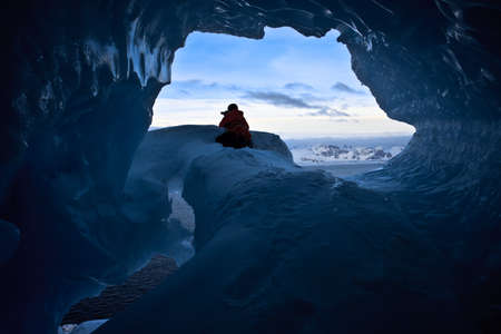 The exit from blue cave in Antarctica Stock Photo