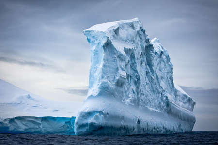 Monolith: Antarctic iceberg in the snow Stock Photo