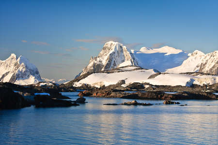 Beautiful snow-capped mountains against the blue sky Stock Photo - 8130578