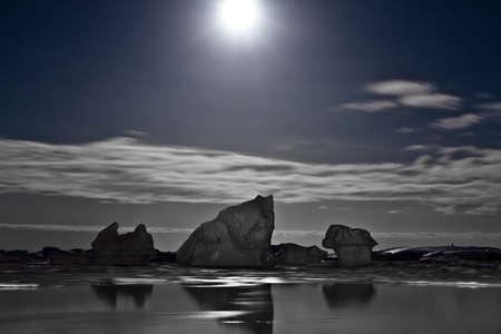 Summer night in Antarctica.Icebergs floating in the moonlight Stock Photo - 8312028