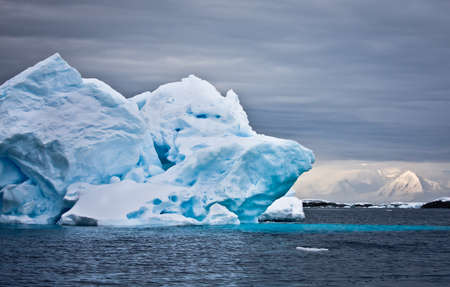 Huge iceberg in Antarctica, dark sky Stock Photo