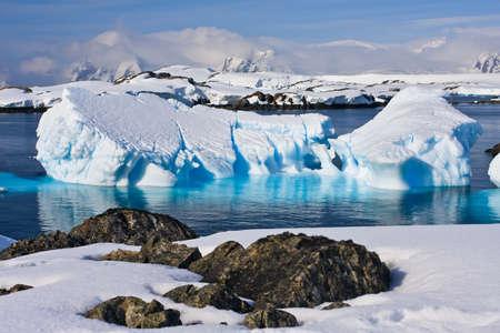 Huge icebergs in Antarctica, blue sky, azure water, sunny day photo