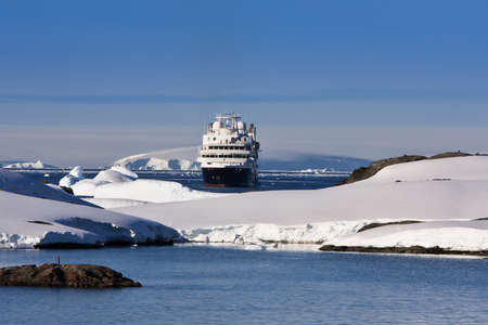 Big cruise ship in Antarctic waters photo