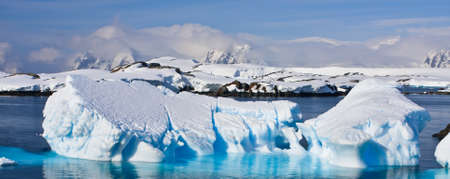 Huge iceberg in Antarctica, blue sky, azure water, sunny day Stock Photo