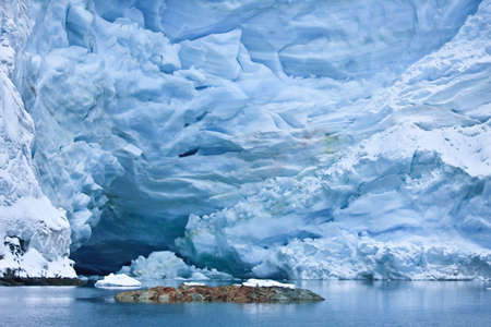 Huge Antarctic iceberg in the snow