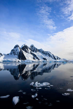 Beautiful snow-capped mountains against the blue sky in Antarctica photo