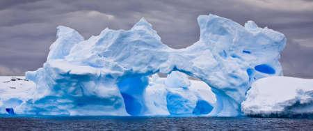 Huge iceberg in Antarctica, dark sky Stock Photo