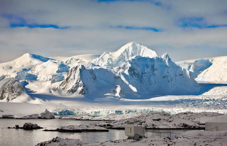 Beautiful snow-capped mountains in Antarctica photo