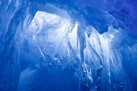 icicle: blue ice cave covered with snow and flooded with light Stock Photo