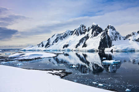 arctic landscape: Beautiful snow-capped mountains against the blue sky in Antarctica