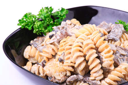 Cooked  pasta with meat and mushrooms photo