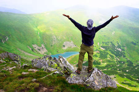 carpathian mountains: Beautiful mountains landscape with lake  in Carpathian mountains and man on the top Stock Photo