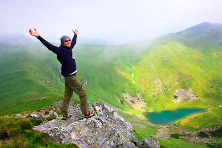 Beautiful mountains landscape with lake  in Carpathian mountains and man on the top Stock Photo