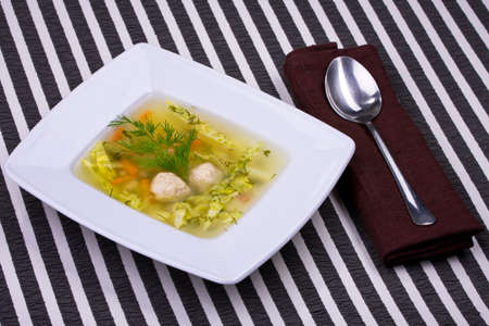 vegetable soup in white bowl with a spoon photo