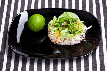 Vitamin salad with lime in the black dish photo