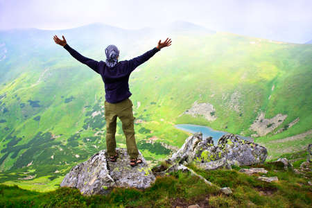 mountain top: Beautiful mountains landscape with lake  in Carpathian mountains and man on the top Stock Photo