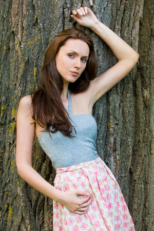 Girl in a grove looking straight photo