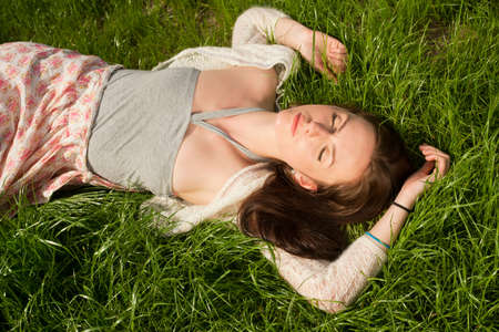 day dreaming: beautiful girl lying on grass and having fun