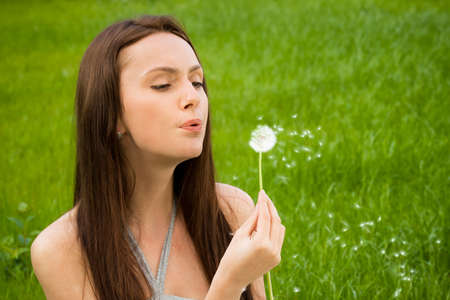 Girl with dandelion on green field Stock Photo - 9798988